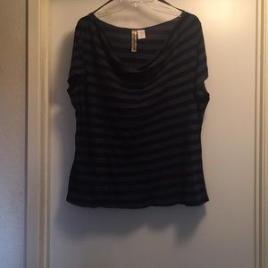 Cap sleeved blouse with draped neckline.